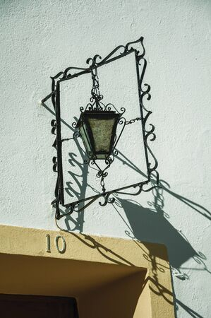 Marvao, Portugal - July 09, 2018. Lamp with wrought iron decoration on top of door of an old house at Marvao. An amazing medieval fortified village perched on a granite crag in eastern Portugal.