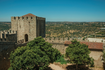 Walls with tower around wooden courtyard and countryside landscape in the Castle of Elvas. A gracious star-shaped fortress city on the easternmost frontier of Portugal. Editorial
