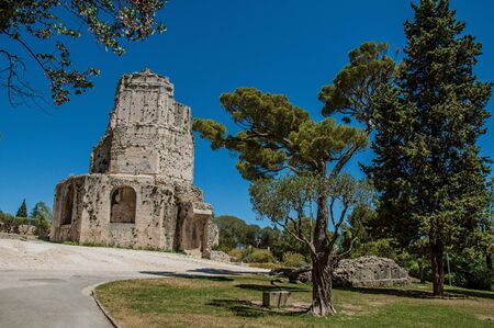 View of the Tour Magne (Magna tower) with blue sky, in the high part of the Gardens of the Fountain, in the city center of Nimes. Located in the Gard department, Occitanie region in southern France Zdjęcie Seryjne