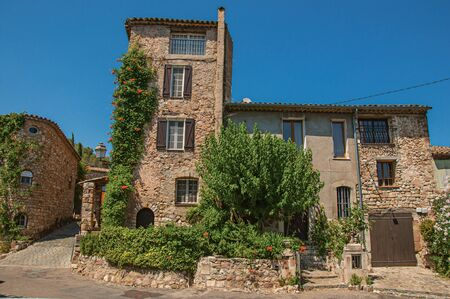 View of old stone houses in alley on sunny day, at the gorgeous medieval hamlet of Les Arcs-sur-Argens, near Draguignan. Located in the Provence region, Var department, southeastern France