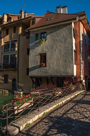Bridge and old buildings facing the canal at sunset, in the city center of historic Annecy. Department of Haute-Savoie, Auvergne-Rhone-Alpes region, southeastern France. Retouched photo. Zdjęcie Seryjne
