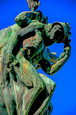 Close-up of bronze sculpture with blue and sunny sky. In a square at the Orvieto city center, an ancient, pleasant and well preserved medieval town. Located in Umbria, central Italy. Retouched photo