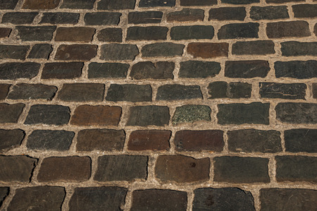 Close-up of stone sidewalk at sunset in the City Center of Ghent. In addition to intense cultural life, the city is full of Gothic and Flemish style buildings. Northern Belgium. Redactioneel