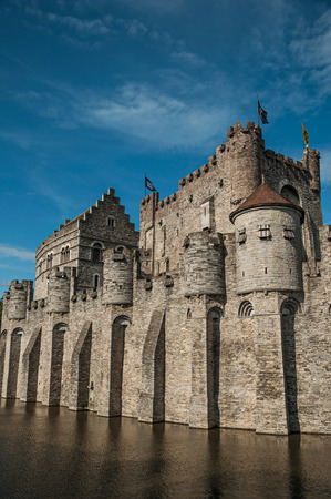 Close-up of stone wall and watchtower of the Gravensteen Castle in Ghent. In addition to intense cultural life, the city is full of Gothic and Flemish style buildings. Northern Belgium.