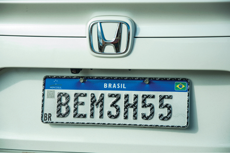 Cambara do Sul, Brazil - July 19, 2019. Car license plate with new design used by countries from Mercosur (Southern Common Market) at Cambara do Sul. A small rural town in eastern of Rio Grande do Sul