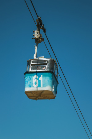 Madrid, Spain - July 24, 2018. Cable car gondola passing through clear blue sky at the Teleferico Park of Madrid. Capital of Spain this charming metropolis has vibrant and intense cultural life. Publikacyjne