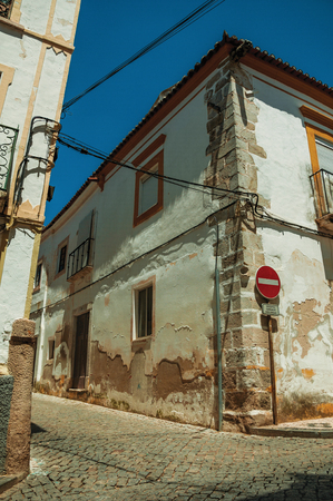 Elvas, Portugal - July 7, 2018. Old houses with peeling plaster and NO ENTRY signpost on sunny day at Elvas. A gracious star-shaped fortress city on the easternmost frontier of Portugal.