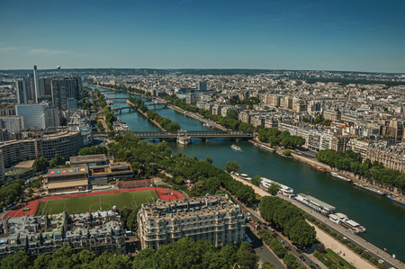 "Paris, France - July 07, 2017. Skyline, River Seine, greenery and buildings, seen from the Eiffel Tower in Paris. Known as the ""City of Light"", is one of the most impressive world's cultural center. Publikacyjne"