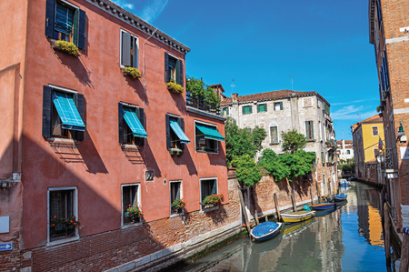 Venice, Italy - May 09, 2013. View of buildings and boats in front of a canal in a sunny day. At the city center of Venice, the historic and amazing marine city. Veneto region, northern Italy Editorial