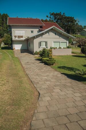 Modern country house with pathway and garden in a rural landscape near Bento Goncalves. A friendly country town in southern Brazil famous for its wine production.