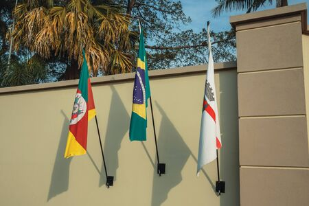 Wall with flags from Brazil, Rio Grande do Sul state and municipality of Bento Goncalves. A friendly country town in southern Brazil famous for its wine production.