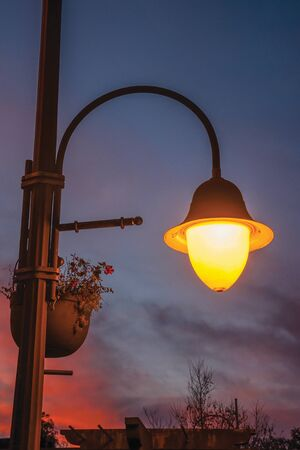 Detail of a decorative light post and colorful sky at sunset in Gramado. A cute european-influenced town in southern Brazil, highly sought after by tourists.