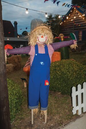 Scarecrow made of colorful clothes in a garden at dusk from a folkloric festival in Canela. A charming small town very popular by its ecotourism in southern Brazil.