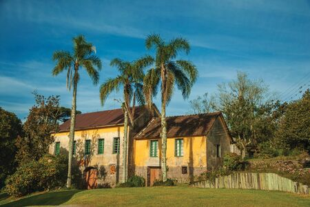 Bento Goncalves, Brazil - July 10, 2019. Countrified house in a traditional Italian-influenced style on a lush garden near Bento Goncalves. A friendly country town famous for its wine production.