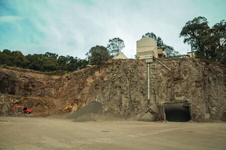 Bento Goncalves, Brazil - July 13, 2019. View of rocky escarpment and equipment in a quarry facility near Bento Goncalves. A friendly country town in southern Brazil famous for its wine production.
