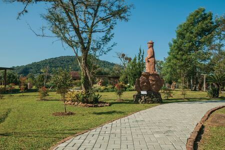 Nova Petropolis, Brazil - July 20, 2019. Sandstone sculptures and paved pathway in a garden at Sculpture Park Stones of Silence near Nova Petropolis. A lovely rural town founded by German immigrants.