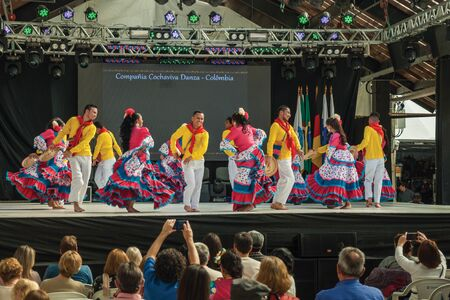 Nova Petropolis, Brazil - July 20, 2019. Colombian folk dancers doing a typical dance and audience on 47th International Folklore Festival of Nova Petropolis. A rural town founded by German immigrants
