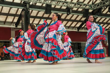 Nova Petropolis, Brazil - July 20, 2019. Colombian female folk dancers performing a typical dance on 47th International Folklore Festival of Nova Petropolis. A rural town founded by German immigrants. Redactioneel