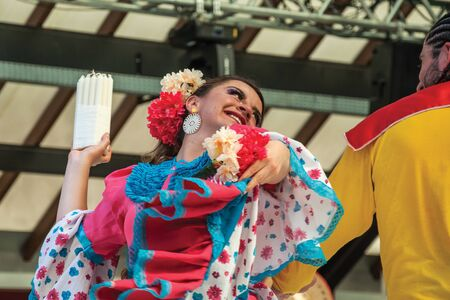 Nova Petropolis, Brazil - July 20, 2019. Colombian female folk dancer performing a typical dance on 47th International Folklore Festival of Nova Petropolis. A rural town founded by German immigrants. Redactioneel