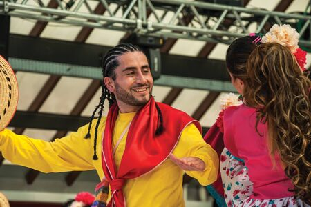 Nova Petropolis, Brazil - July 20, 2019. Couple of Colombian folk dancers doing a typical dance on 47th International Folklore Festival of Nova Petropolis. A rural town founded by German immigrants.