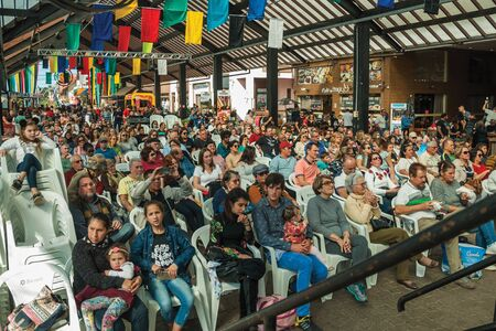 Nova Petropolis, Brazil - July 20, 2019. People from audience watching the show at the 47th International Folklore Festival of Nova Petropolis. A lovely rural town founded by German immigrants. Redactioneel