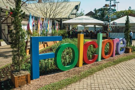 Nova Petropolis, Brazil - July 20, 2019. Colorful sign with the word folklore in a garden at the 47th International Folklore Festival of Nova Petropolis. A rural town founded by German immigrants.