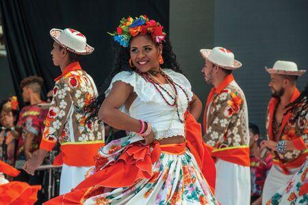 Nova Petropolis, Brazil - July 20, 2019. Brazilian female folk dancer performing a typical dance on 47th International Folklore Festival of Nova Petropolis. A rural town founded by German immigrants.