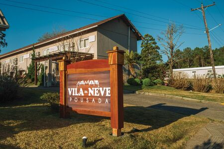 Gramado, Brazil - July 21, 2019. Entrance with garden and signboard from Villa da Neve guesthouse in Gramado. A cute european-influenced town highly sought after by tourists. Redactioneel