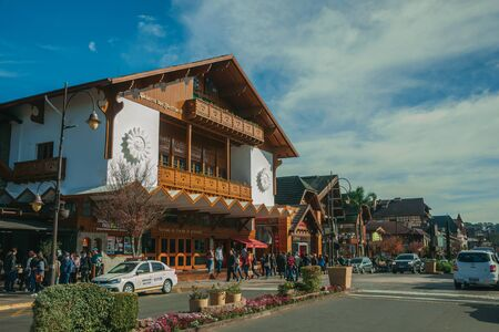 Gramado, Brazil, July 21, 2019. Charming facade from Festivals Palace and people on Borges de Medeiros Avenue, the main street of Gramado. An european-influenced town highly sought after by tourists.