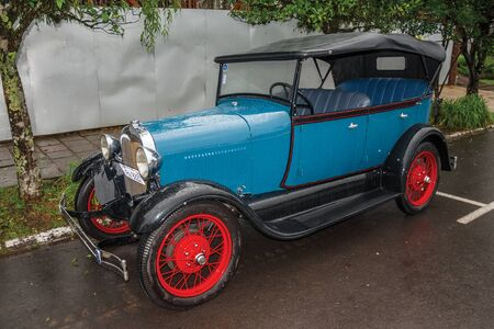 Gramado, Brazil - July 23, 2019. Antique Ford 1929 car in perfect condition, parked on a rainy day in a street of Canela. A charming small town very popular by its ecotourism. Editorial