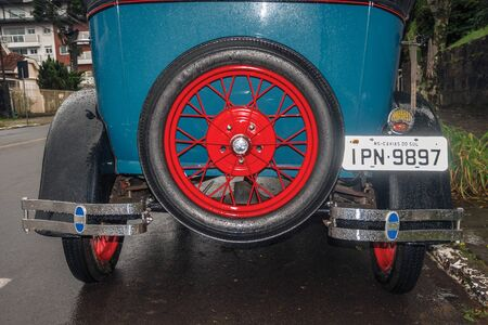 Gramado, Brazil - July 23, 2019. Detail of spare tire in the back of antique Ford 1929 car in perfect condition, on a rainy day in Canela. A charming small town very popular by its ecotourism. Redactioneel