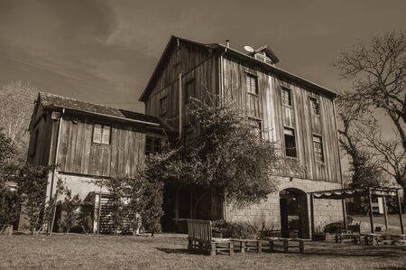 Bento Goncalves, Brazil - July 11, 2019. Charming wooden old house at the restaurant Casa Vanni near Bento Goncalves. A country town famous for its wine production. Black and white photo.