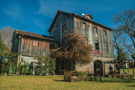 Bento Goncalves, Brazil - July 11, 2019. Charming old rural house from the restaurant Casa Vanni with customers entering, near Bento Goncalves. A friendly country town famous for its wine production.