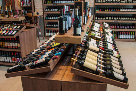 Sao Paulo, Brazil – August 10, 2019. Several bottles of wine for sale displayed on shelves from a wine shop of Sao Paulo. The gigantic city, famous for its cultural and business vocation. Editorial