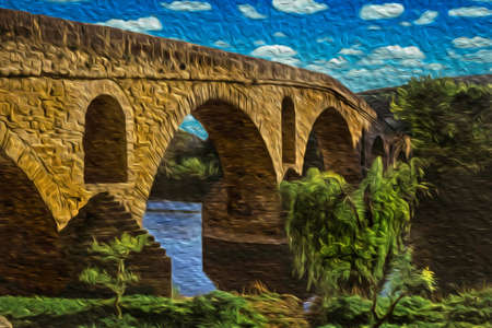 Gothic stone bridge on the Arga River at sunset in Puente La Reina. A medieval village on the Way of St. James, a famous pilgrimage route leading to Santiago de Compostela in Spain. Oil paint filter.