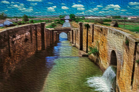 Large water canal going through countryside fields in a sunny day at the Way of St. James. A famous pilgrimage route leading to Santiago de Compostela in northern Spain. Oil paint filter.