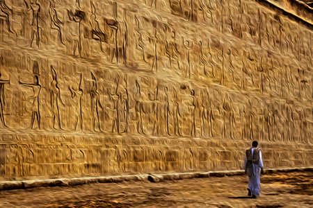 Wall with hieroglyphs carved by the ancient Egyptians in the Edfu temple and visitor walking, near Aswan. A village of enormous archaeological significance in southern Egypt. Oil paint filter.