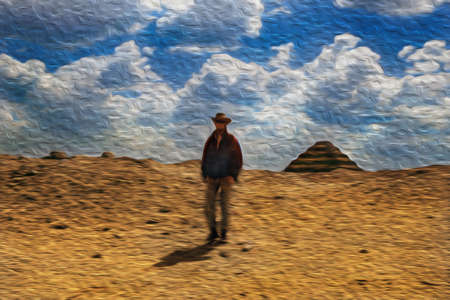 Man walking on the desert near the Djoser Pyramid, the oldest stone building complex known in history. Located in Saqqara, an archaeological site on the desert, southwest of Egypt. Oil paint filter.
