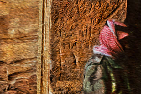 Bedouin standing in front of an old stone wall in the ancient archeological site of Petra. An amazing historic city with buildings carved out of the cliffs in southern Jordan. Oil paint filter.