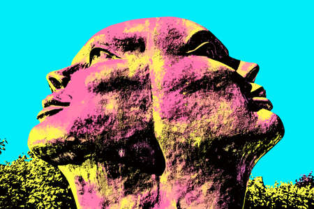 Big statue of two fused heads in a garden near Damme. A quiet and charming countryside old village near Bruges. Blacklight Poster filter.