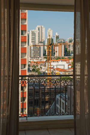 City skyline seen from a balcony in a building in São Paulo. The gigantic city, famous for its cultural and business vocation in Brazil.