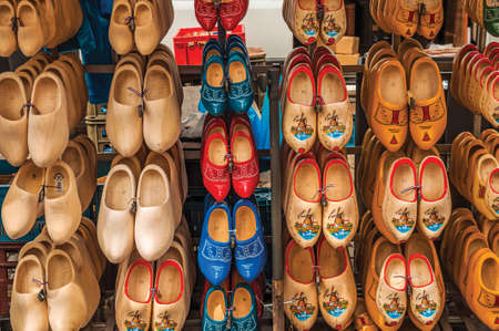 Gouda, Netherlands - June 29, 2017. Display with several types of colored wooden clogs, in a typical Low Countries style at Gouda. A town popular for its typical cheese in Netherlands.