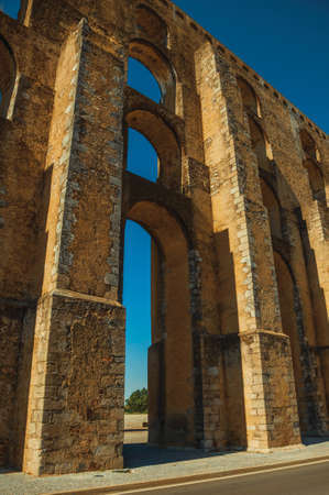 Architectural structure of the Mulberry Aqueduct with arches and rectangular pillars at Elvas. A gracious star-shaped fortress city in Portugal.
