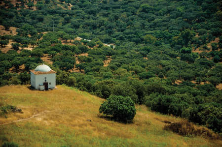 Countryside landscape with small chapel over a hill and green valley near Evoramonte. A fortified civil parish over hill in Portugal.