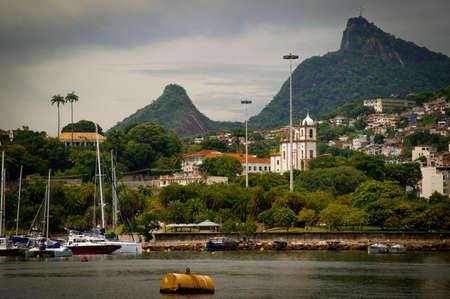 gloria: Cristo Redentor as seen from a boat in the Baia de Guanabara in Rio de Janeiro