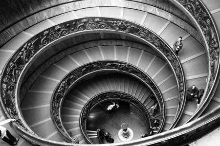 Black and white shot of ornate Spiral Stairs inside the Vatican Museum in Rome, Italy