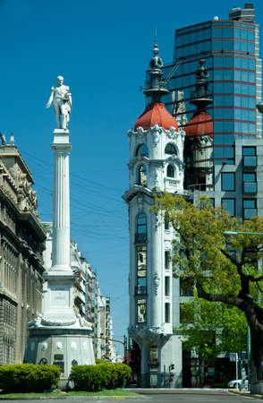Statue with Edificio de Tucuman building, Buenos Aires, Argentina