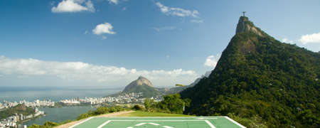 rio: Distant view of Christ The Redeemer on top of the Corcovado Mountain, Rio De Janeiro, Brazil Editorial