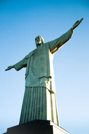 Low angle view of Christ the Redeemer statue with blue sky background, Rio de Janeiro, Brazil.