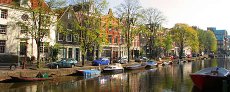 Panoramic view of boats on canal in Amsterdam city, Netherlands. Editorial